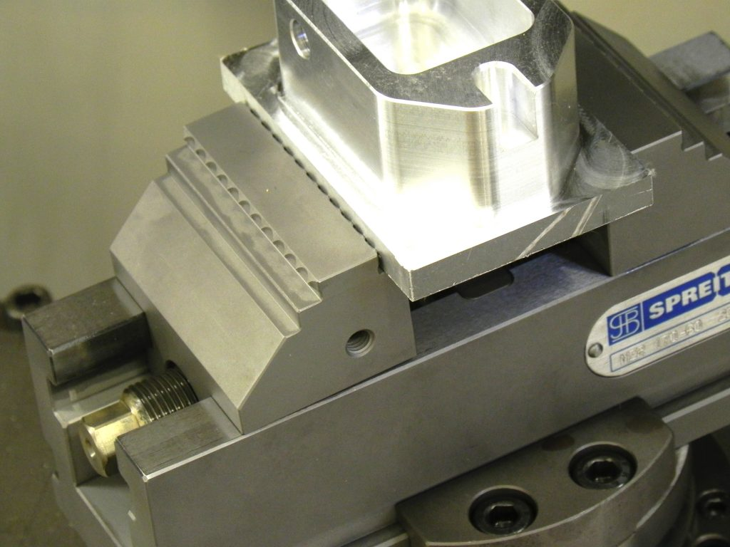 """></p></p><p>As ETG Workholding's Product Manager Rob Beckett explains, """"there are many options for raw material clamping but the vice is only part of the solution.&nbsp; Raw materials mostly need pre-stamping which adds further cost over and above the purchase cost of the vice and adds time to what is essentially a very straight forward operation.</p><p>""""MZR vices are ideal for working on multi-axis machining centres,"""" he adds """"as they are a compact design with a small trunnion footprint yet still offer maximum access and the ability to enlarge the clamping width with reversible jaws.""""</p><p>Raw part machining (first set up) uses the grip jaw option with the second set up for finish machining using the smooth jaw option – all without pre-stamping.</p><p><img></p><p><p><img src="""
